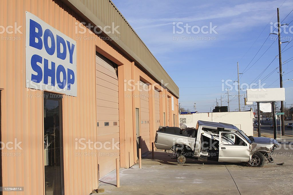 Automobile Body Shop with Wrecked Vehicle stock photo