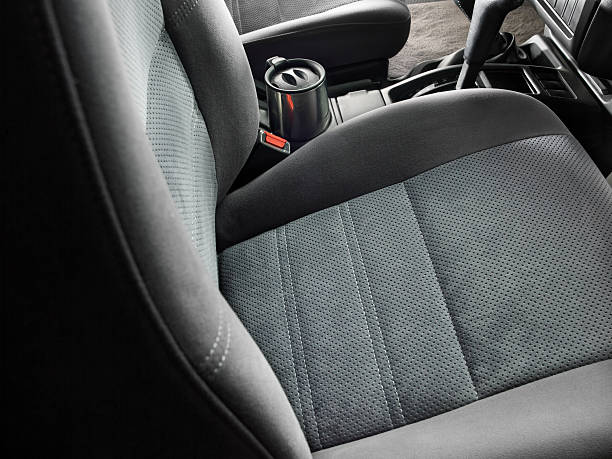 Automobile, Car Interior Tight shot of a car interior main focus on the car's gray cloth bucket seat. seat stock pictures, royalty-free photos & images