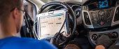 istock Automobile computer diagnosis. Car mechanic repairer looks for engine failure 1190638782
