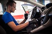istock Automobile computer diagnosis. Car mechanic repairer looks for engine failure 1190639006