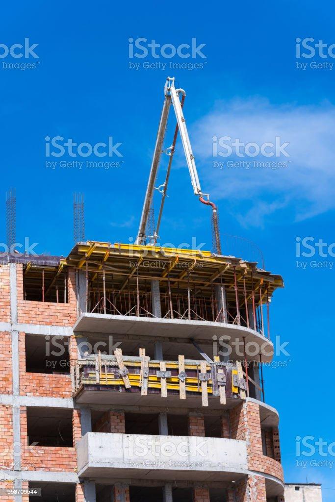 Automobile concrete pump. New multi-storey building. stock photo