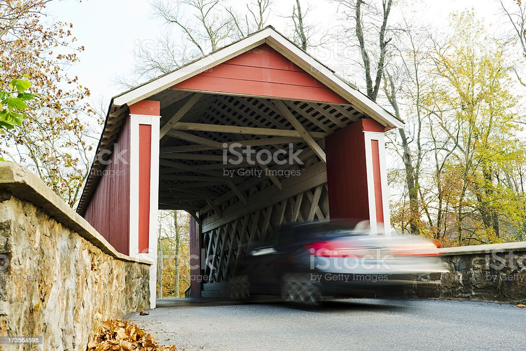 Automobile Entering Covered Bridge stock photo