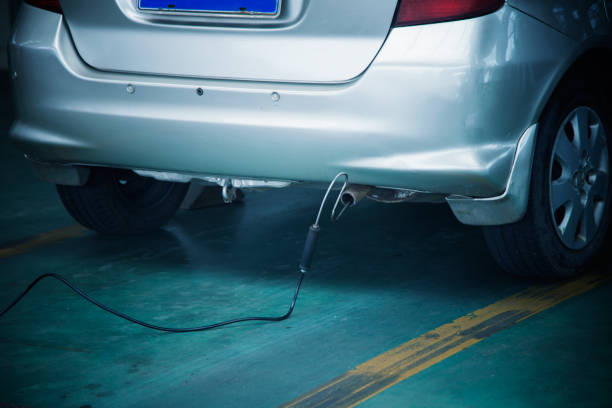 Automobile exhaust emission test Automobile exhaust emission test smog stock pictures, royalty-free photos & images