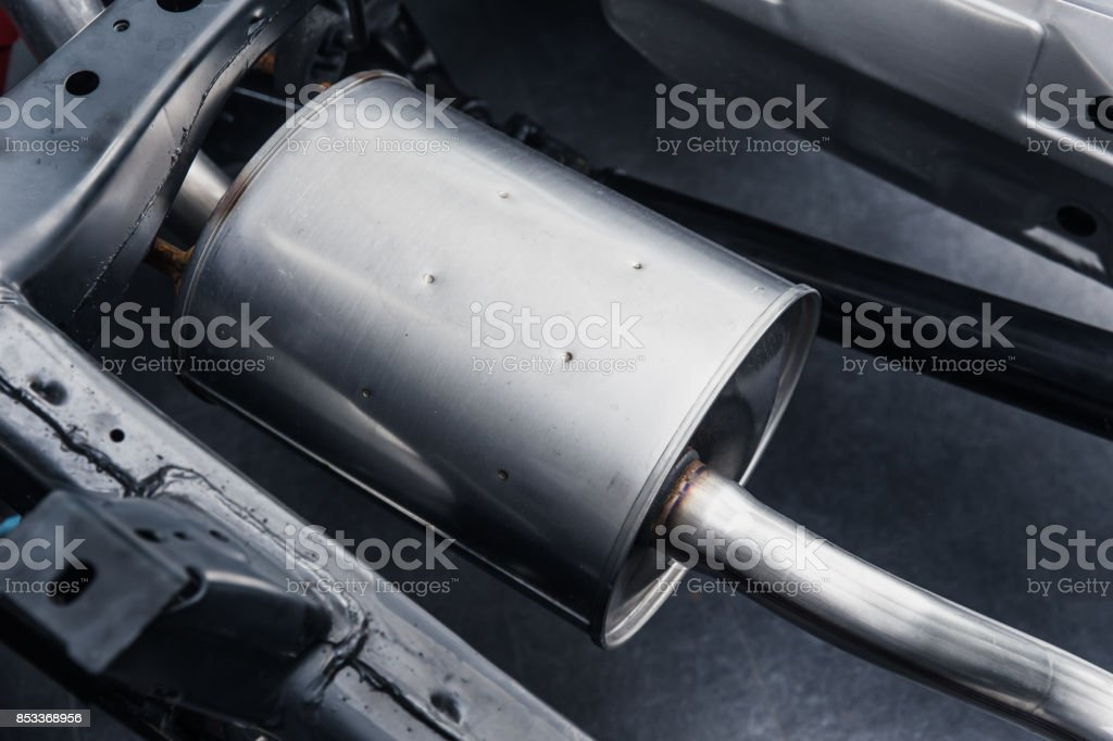 Automobile exhaust pipe muffler clean new stock photo