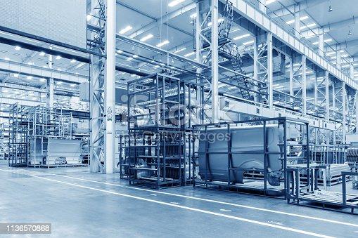 istock Automobile factory warehouse 1136570868