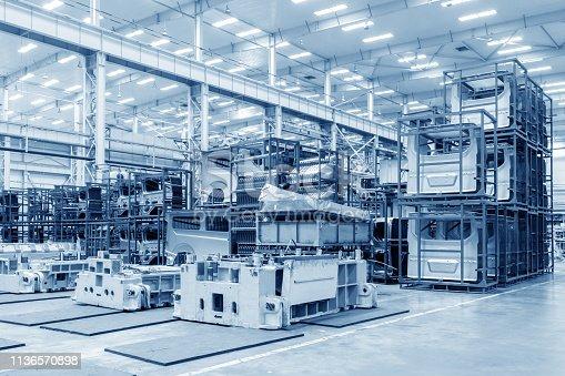 istock Automobile factory warehouse 1136570898