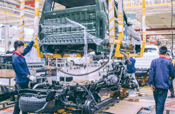 Automobile factory welding assemble line Workers in an automoble factory in Beijing,China. production line stock pictures, royalty-free photos & images