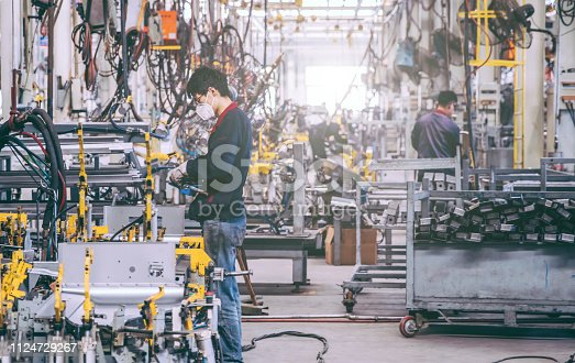 941796726istockphoto Automobile factory welding assemble line 1124729267