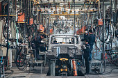 Workers in an automoble factory in Beijing,China.