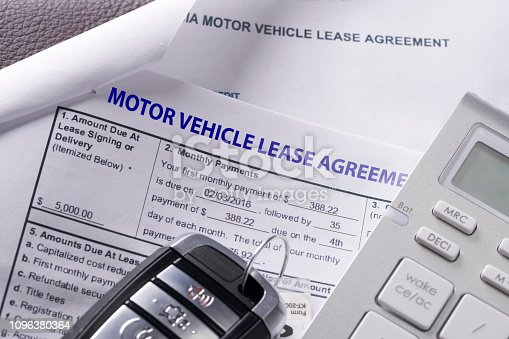 539841066istockphoto Automobile lease agreement document with key and pen on contract 1096380364