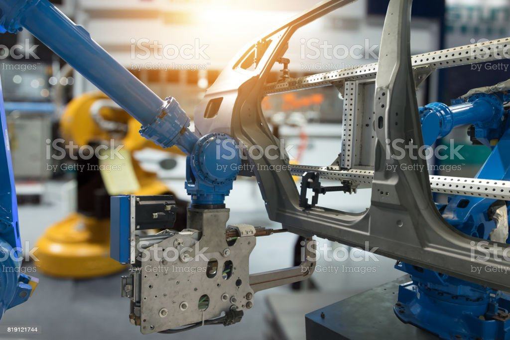 Automobile manufacturing production industrial machine , factory robot arm in smart factory and industry 4.0 concept. Flare light effect. stock photo