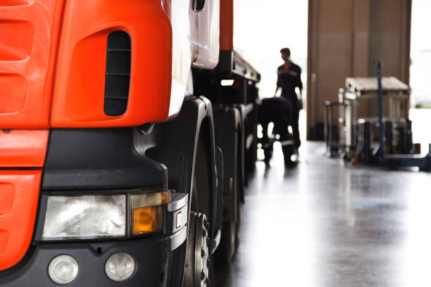automobile mechanic checking truck in the garage, selective focus - transport truck tyres foto e immagini stock