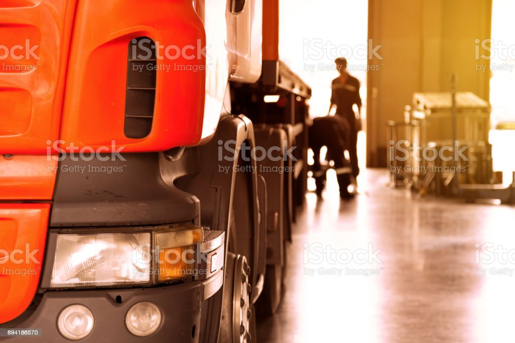 automobile mechanic checking truck in the garage with sunbeam, selective focus stock photo