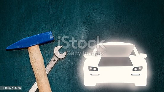 istock automobile repair concept photo with hammer and spanner 1164759076