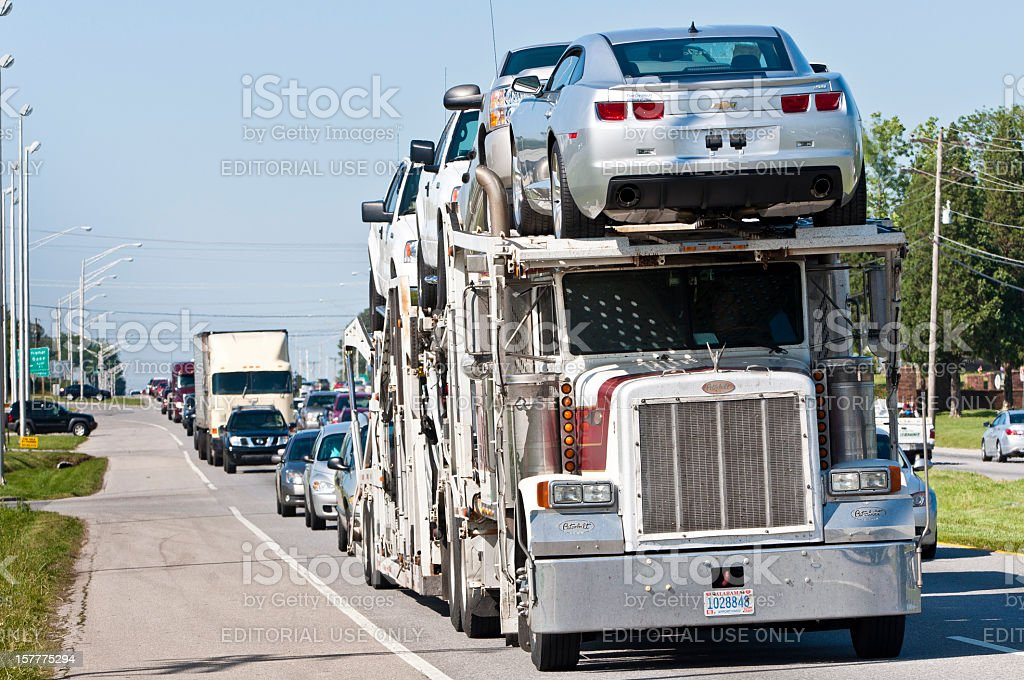 Automobile Transport Truck Caught In Heavy Traffic royalty-free stock photo