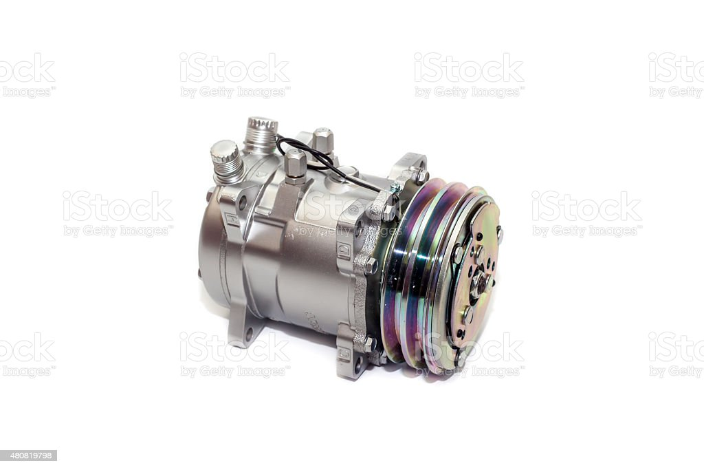 automotive air conditioning compressor on a white background. stock photo
