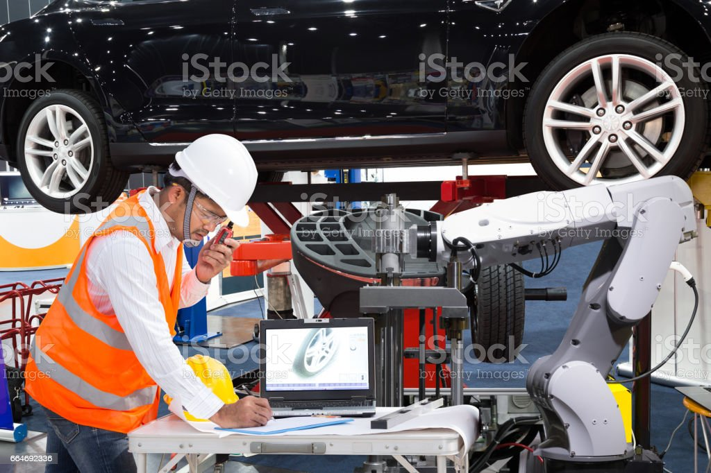 Automotive engineer with assistance robotic inspec modern car, Industry 4.0 stock photo