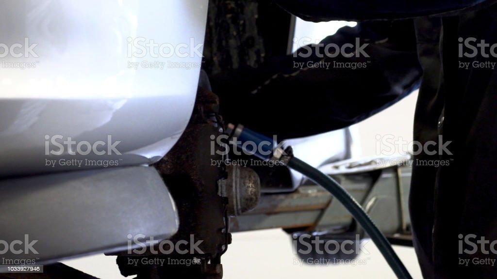 Automotive mechanics swaps the wheel on the vehicle.