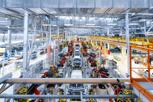 Automotive production line. Welding car body. Modern car Assembly plant stock photo
