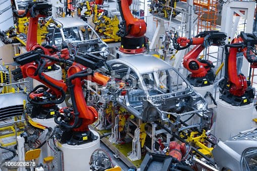 1069360792 istock photo Automotive production line. Welding car body. Modern car Assembly plant 1066926878