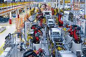 istock Automotive production line. Welding car body. Modern car Assembly plant 1069360792