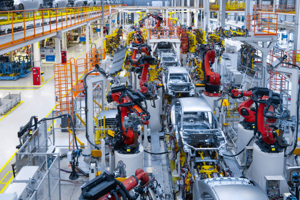 línea de producción automotriz. soldadura de la carrocería. coche moderno planta de ensamblaje de - robot fotografías e imágenes de stock