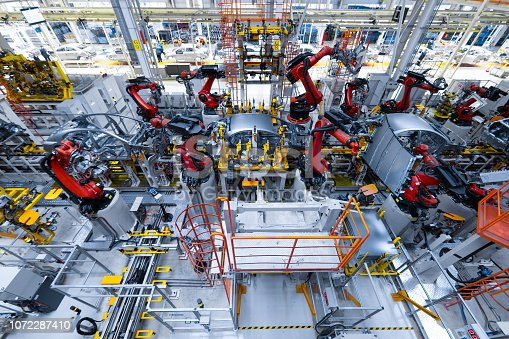 1069360792 istock photo Automotive production line. Welding car body. Modern car Assembly plant 1072287410