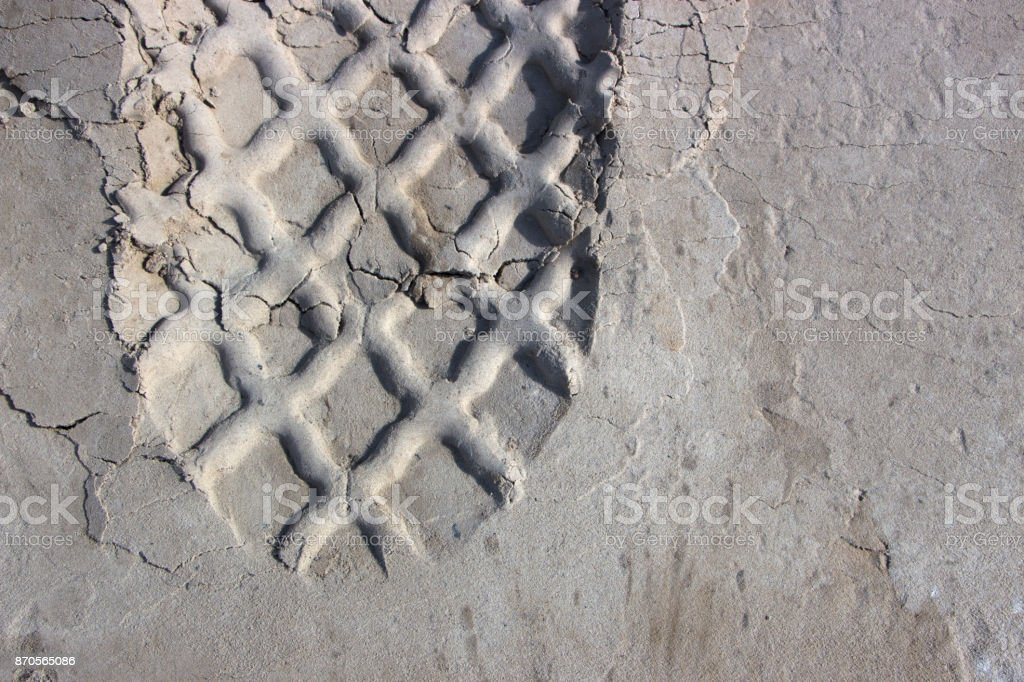 automotive tire track on the sand stock photo
