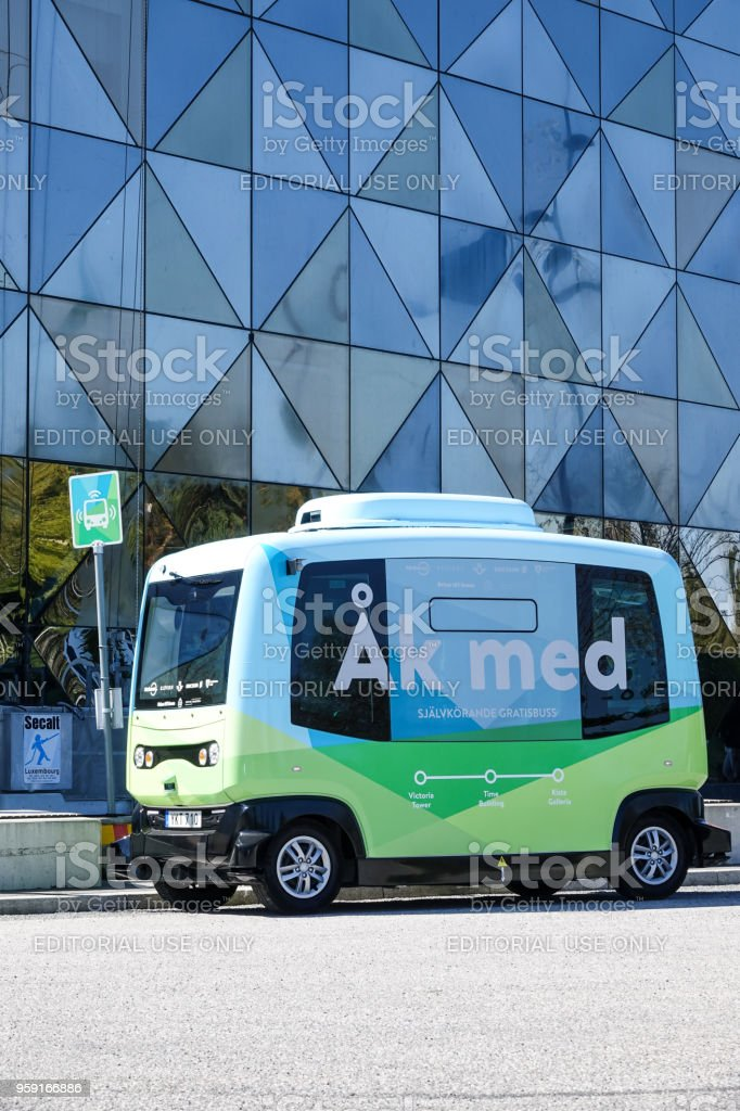 Autonomous bus / car / vehicle in front of Scandic Victoria Tower stock photo