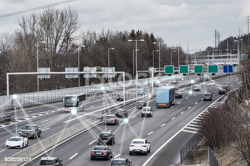 istock Autonomous Cars on Road 938556124