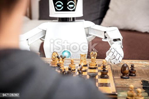 istock autonomous cyborg or roboter is playing chess, concept strategy or adaptive ki with chess computer 947128282