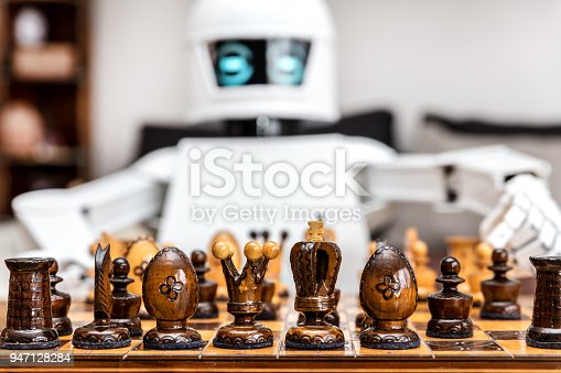 istock autonomous cyborg or roboter is playing chess, concept strategy or adaptive ki with chess computer 947128284