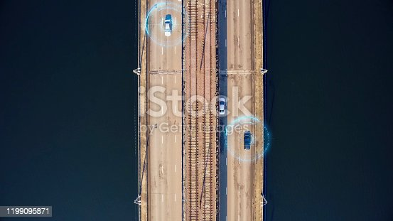870169952 istock photo Autonomous self-driving cars on city bridge, aerial top view. Driverless autos and artificial intelligence system with sensors wireless communication. Future transportation technology concept 1199095871