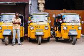 Trivandrum, India - December 14, 2011: Indian auto rickshaws in street. Auto rickshaws (called \