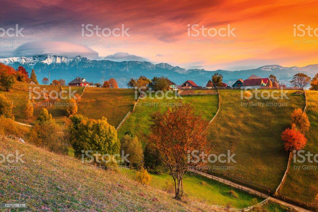 Autumn alpine rural landscape near Brasov, Magura village, Transylvania, Romania stock photo