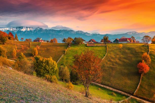 autumn alpine rural landscape near brasov, magura village, transylvania, romania - romania stock pictures, royalty-free photos & images