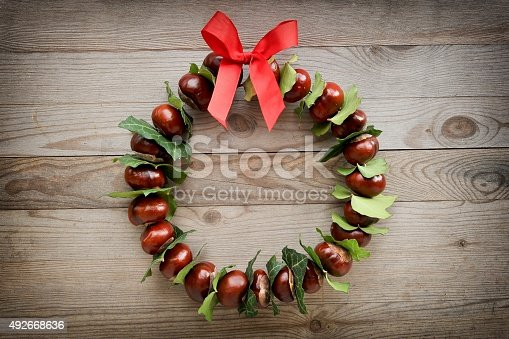 istock Autumn and christmas wreath 492668636