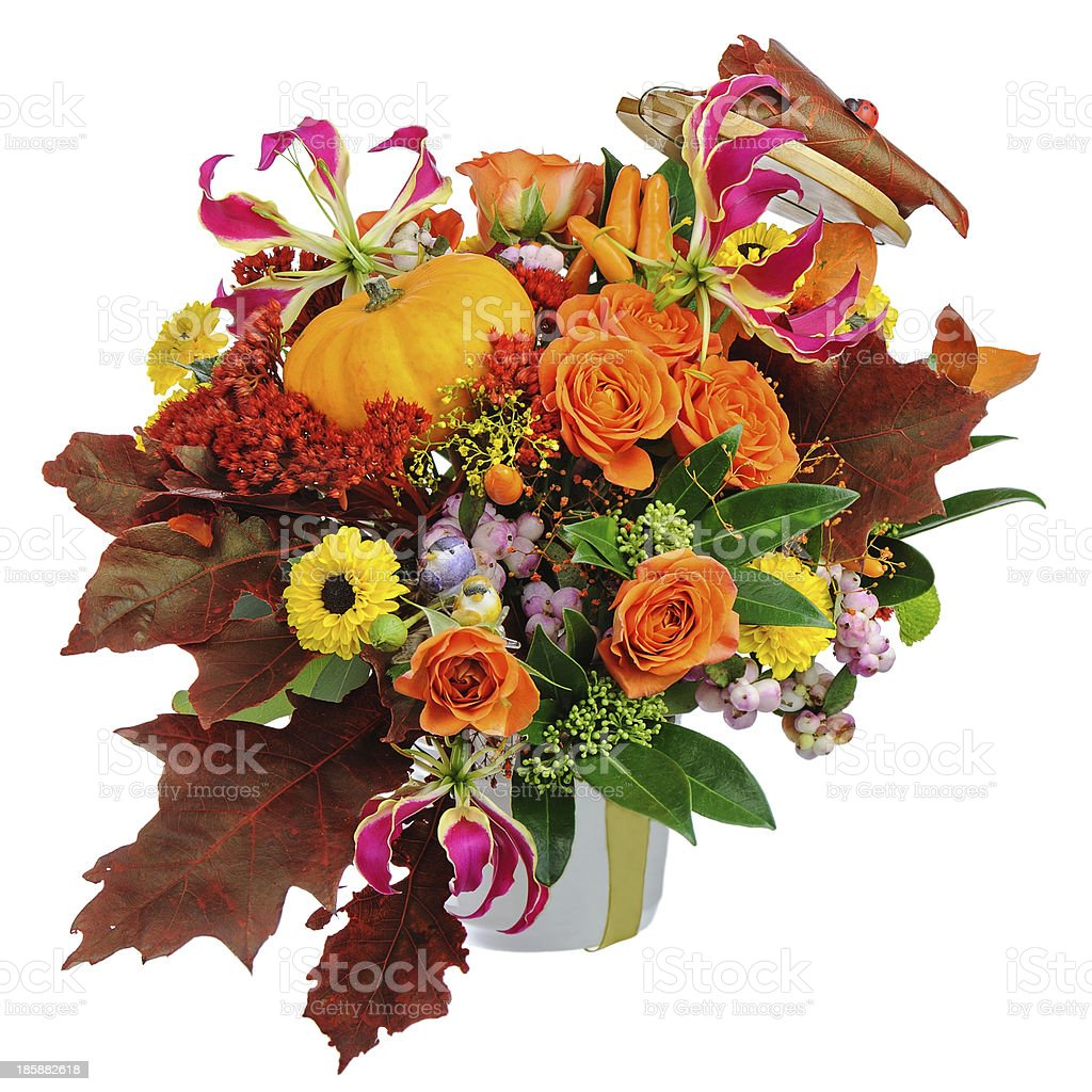 Autumn arrangement of flowers, vegetables and fruits isolated on royalty-free stock photo
