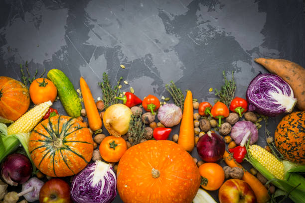 Autumn background: autumn vegetables, fruits, nuts on a beton background stock photo