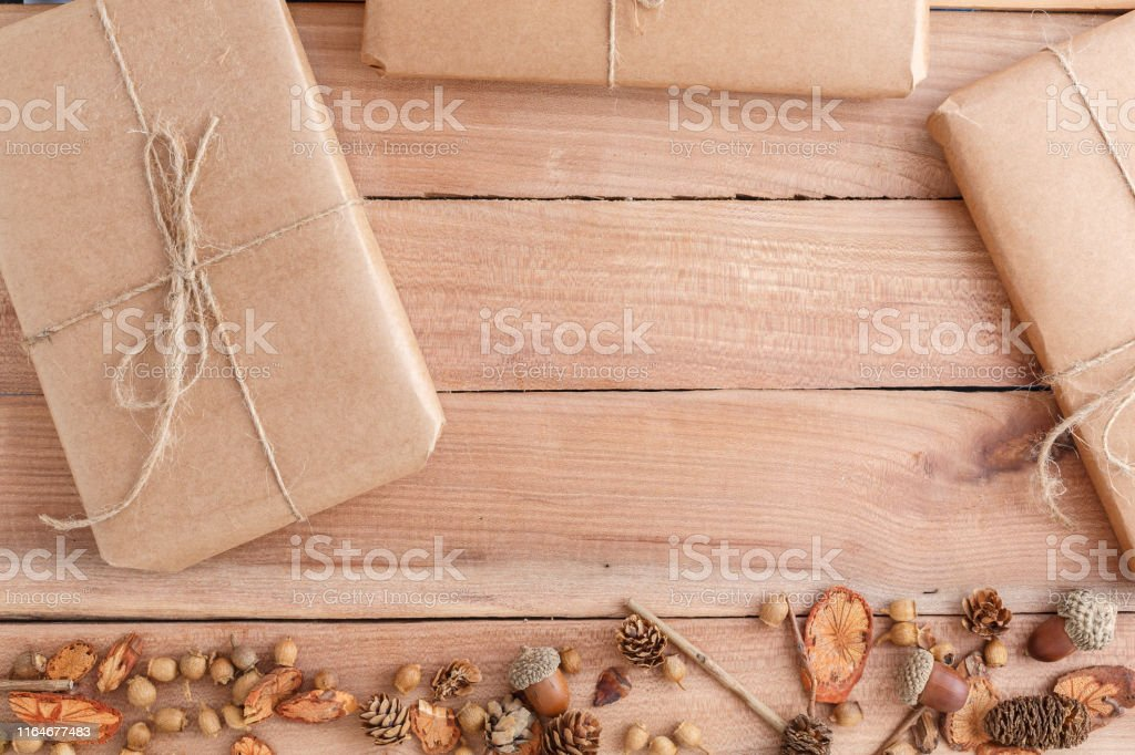 autumn background. cones,acorns and pieces of wood with a Packed...