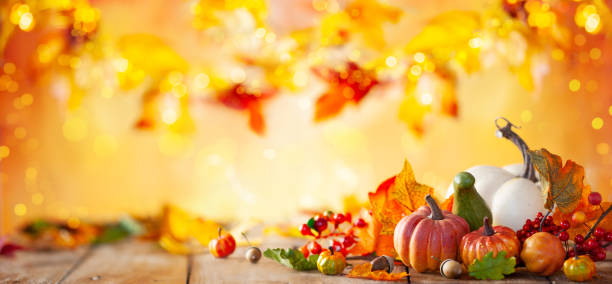 autumn background from fallen leaves and pumpkins on wooden vintage table. - thanksgiving стоковые фото и изображения