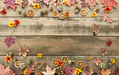 Autumn fall leaf arrangement background on old distressed wood