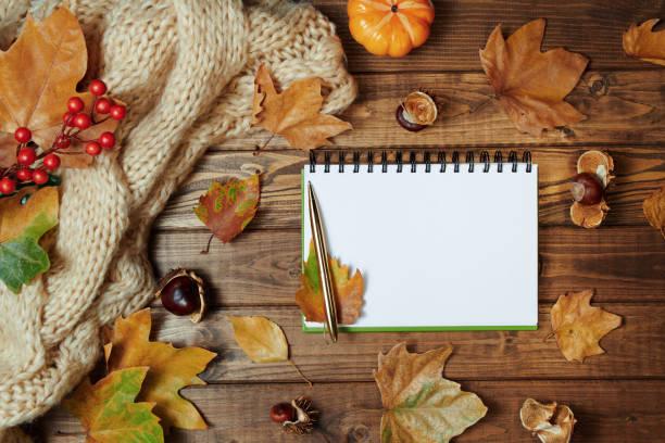autumn background on wooden planks stock photo