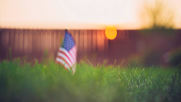 Autumn background with American flag in sunlight stock photo