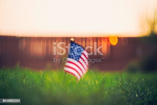 istock Autumn background with American flag in sunlight 844680034