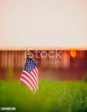 istock Autumn background with American flag in sunlight 844680166