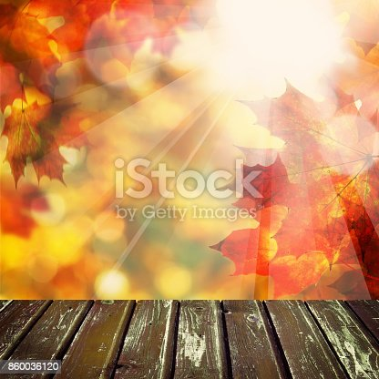 Autumn Background with Empty Wooden Table, Golden Bokeh and Fall Maple Leaves for a Catering or Food Board. Country Outdoor Template for Display of Product