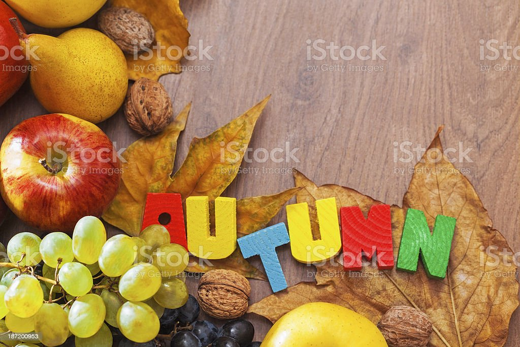 Autumn background with fruit and dried leaves royalty-free stock photo