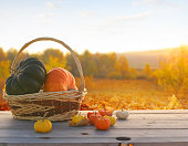 istock Autumn background with maple leaves and pumpkins.Harvest or Thanksgiving background 1283561688