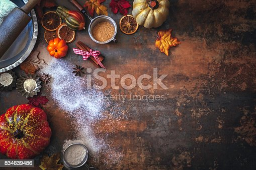 istock Autumn Background with Nuts, Spices and Candied Oranges 834639486
